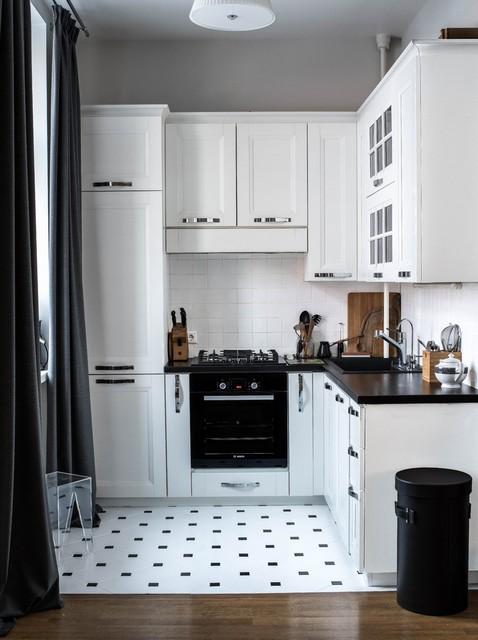 белая скандинавская кухня с черной столешницей